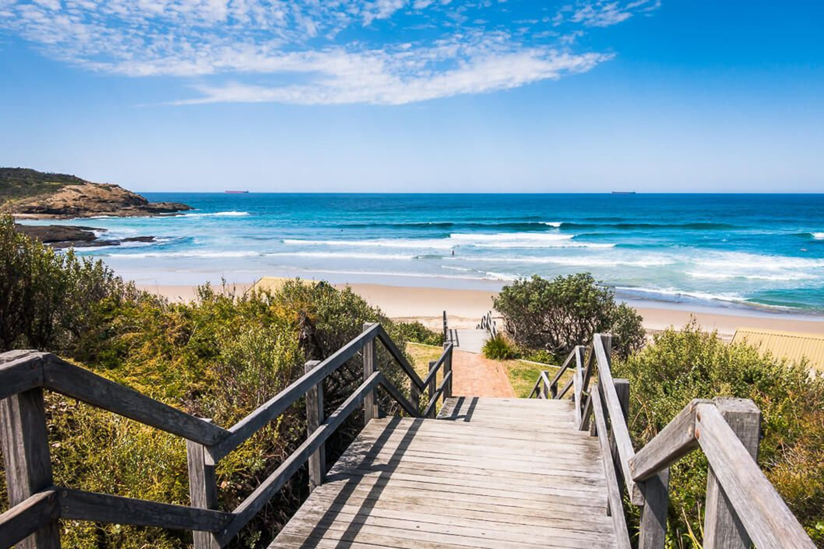 view of a frazer beach from wooden stairs