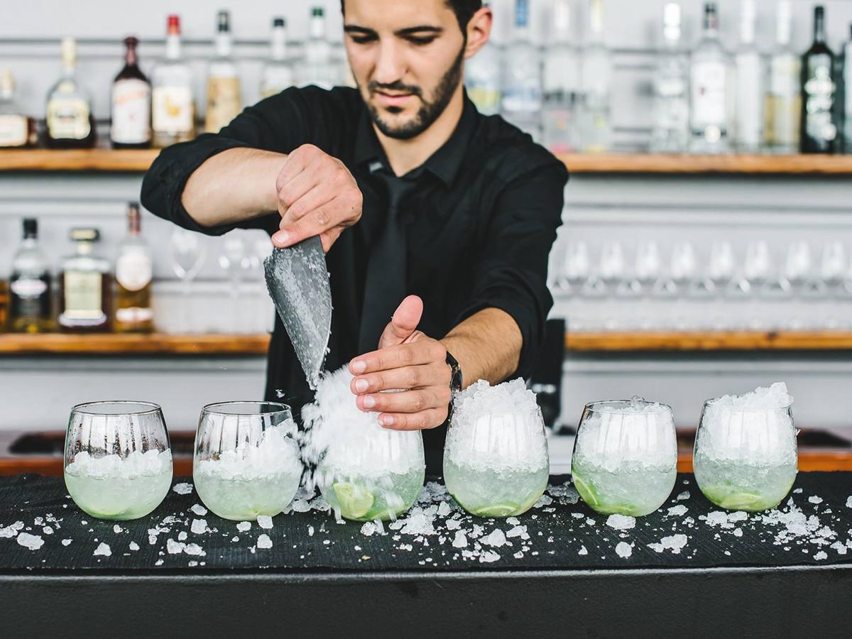 bartender serving drinks at little fish