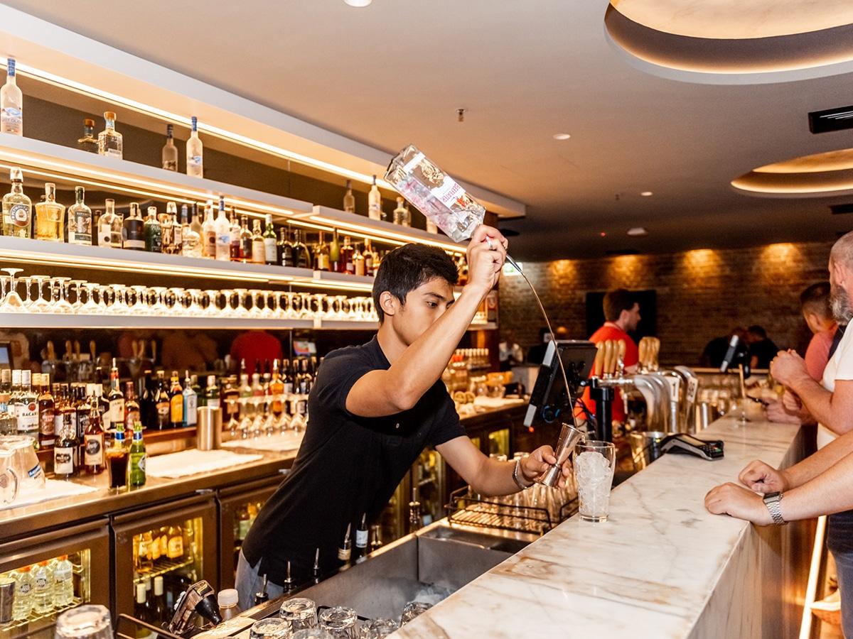 bartender serving drink at middlebar