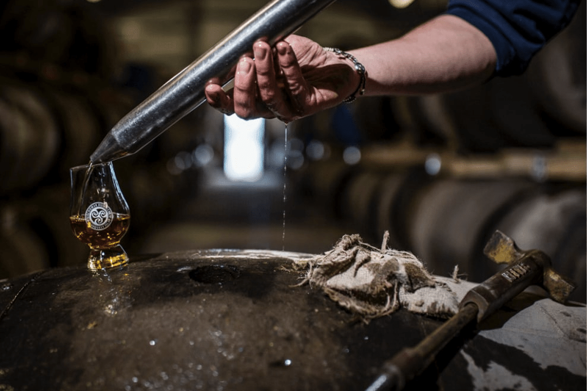 Kilchoman distillery loch gorm pouring
