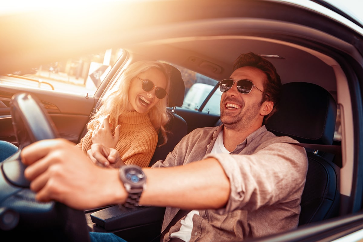 happy Laughing man and woman in car