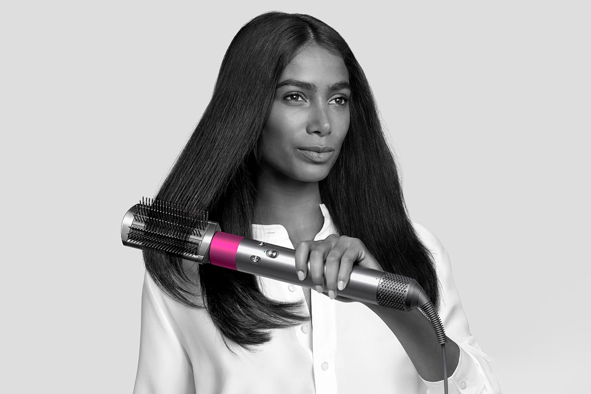 woman with dyson airwrap styler