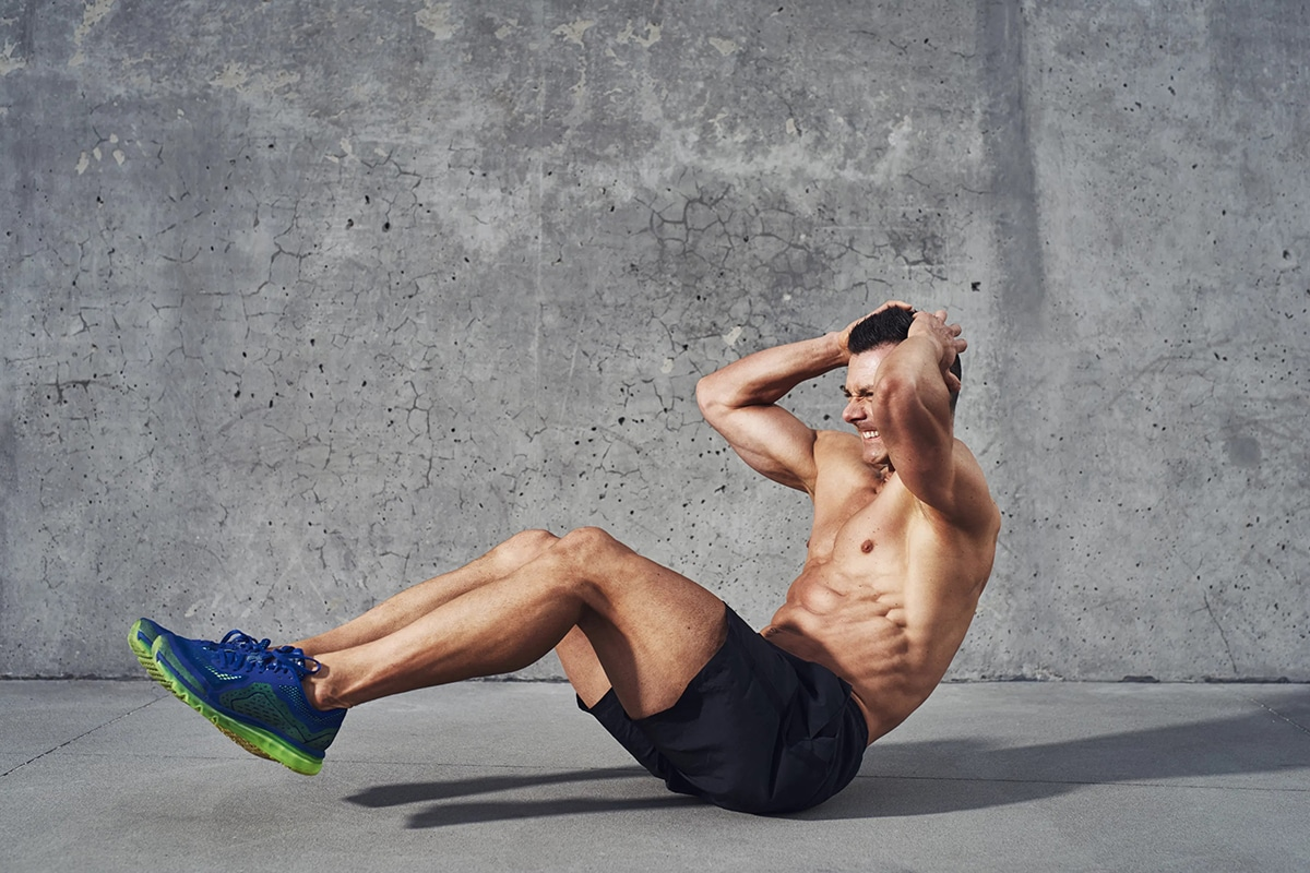 athletic men doing abs workout