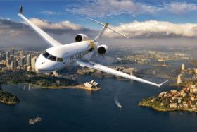 Twiggys private jet flying over sydney