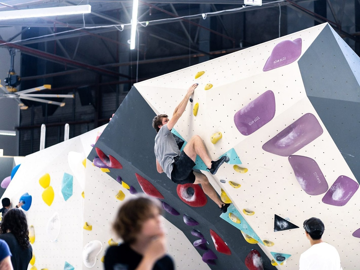 man climbing wall in blochaus bouldering port melbourne
