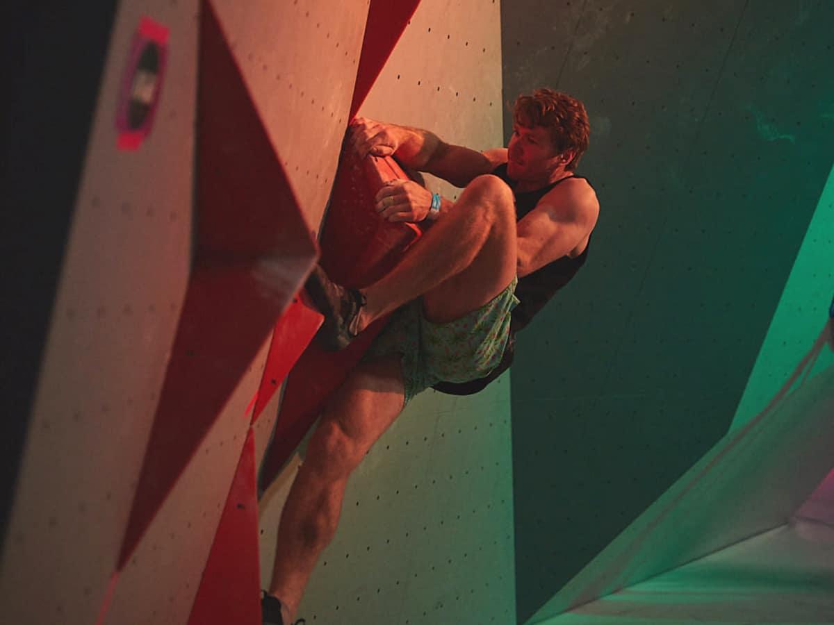 man climbing wall in boulder lab rock climbing gym