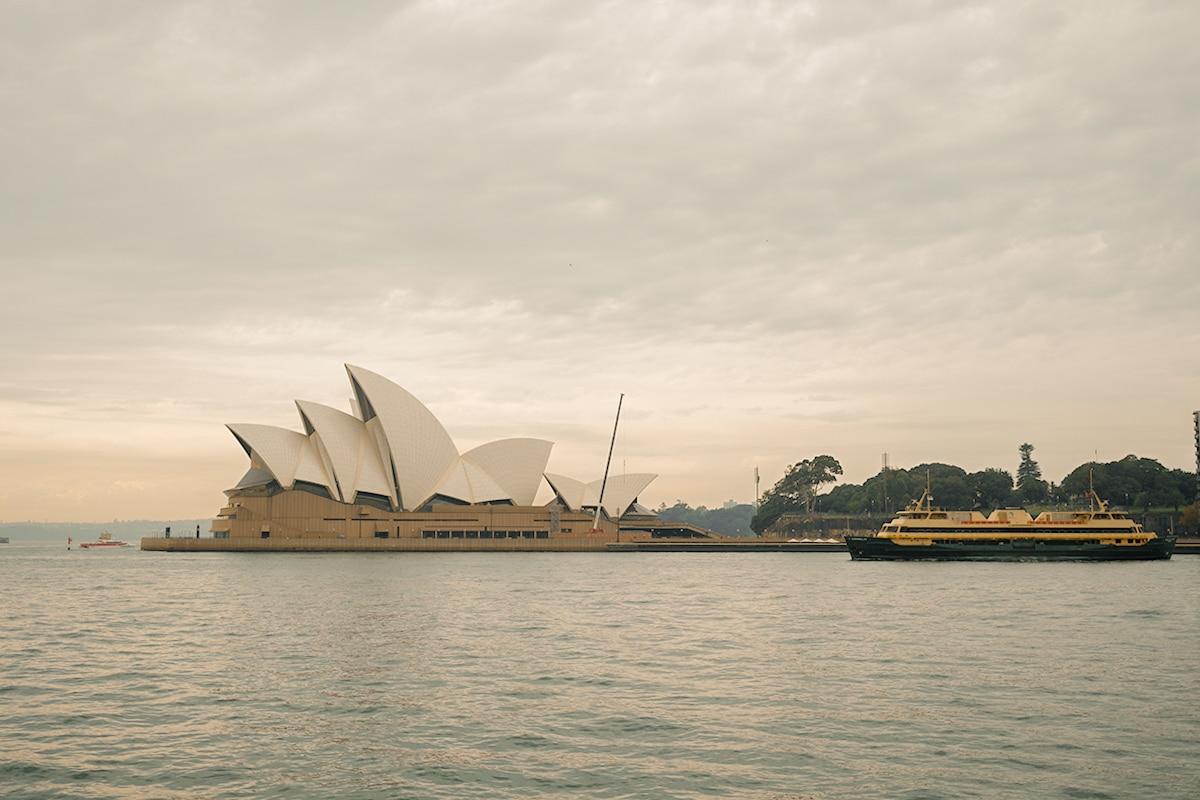 Boat passing opera house