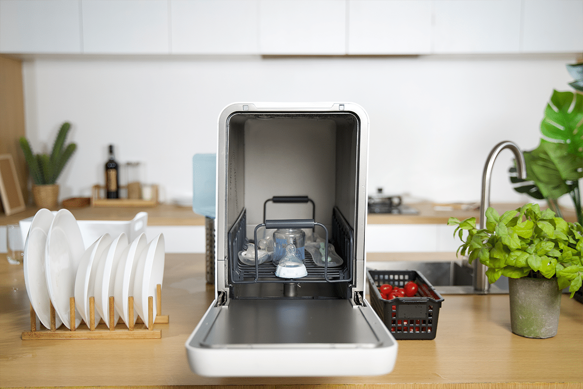 Capsule 3 in 1 dishwasher on countertop opened 2