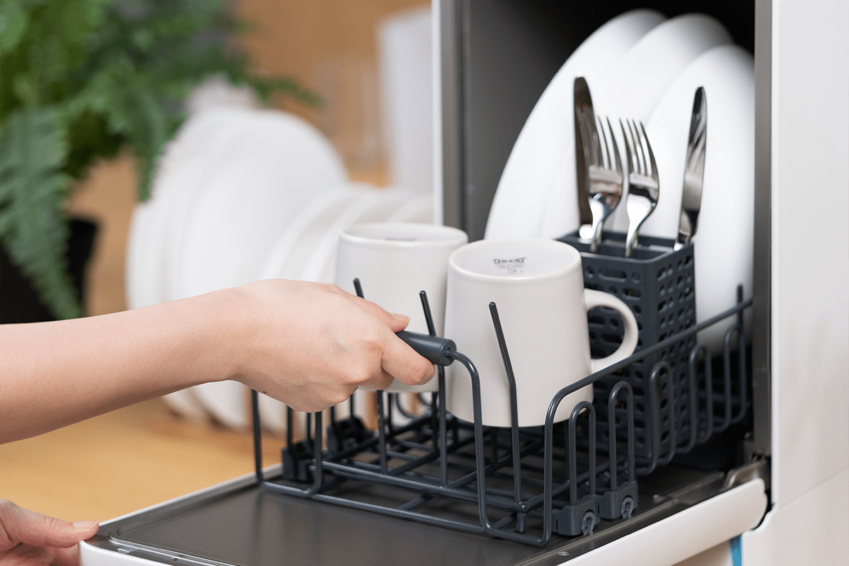 Capsule 3 in 1 dishwasher on countertop opened