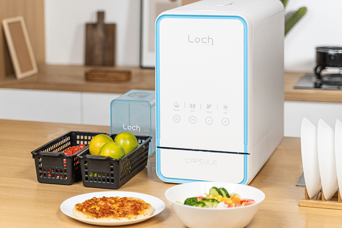Capsule 3 in 1 dishwasher on countertop with food 1