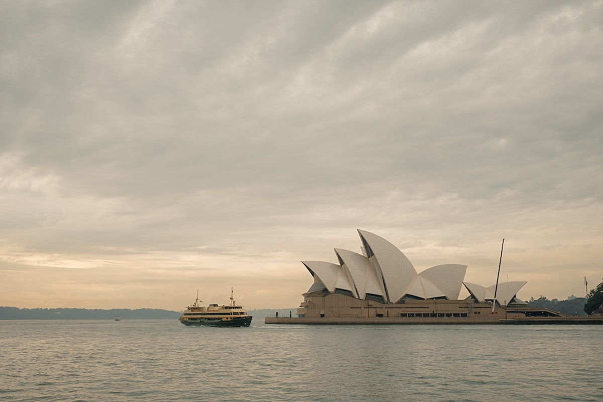 Ferry passing opera house in morningg