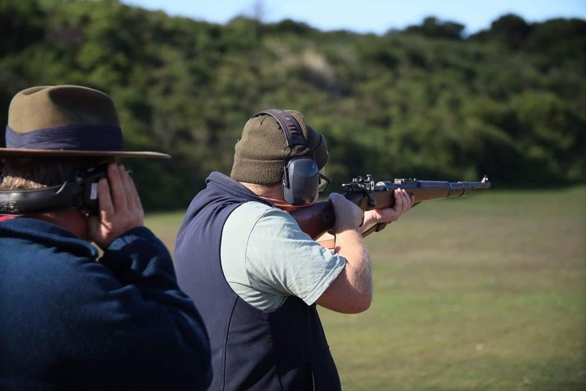 Man aiming shotgun at anzac rifle range