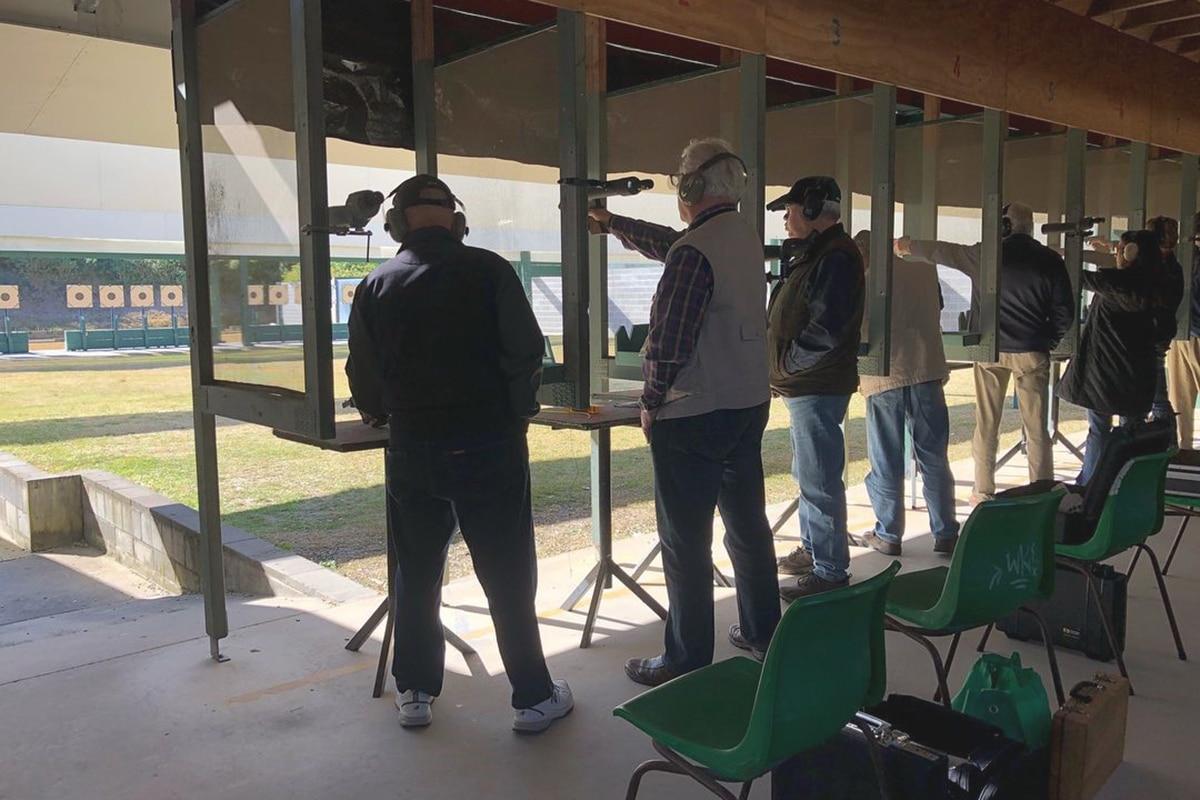 Group Of People Practice Gun Shooting on St Ives Pistol Club
