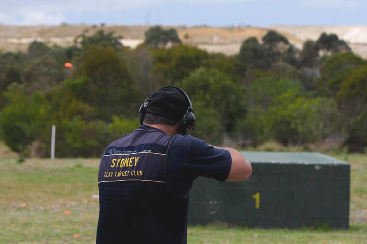 Man Aiming Gun At clay target club