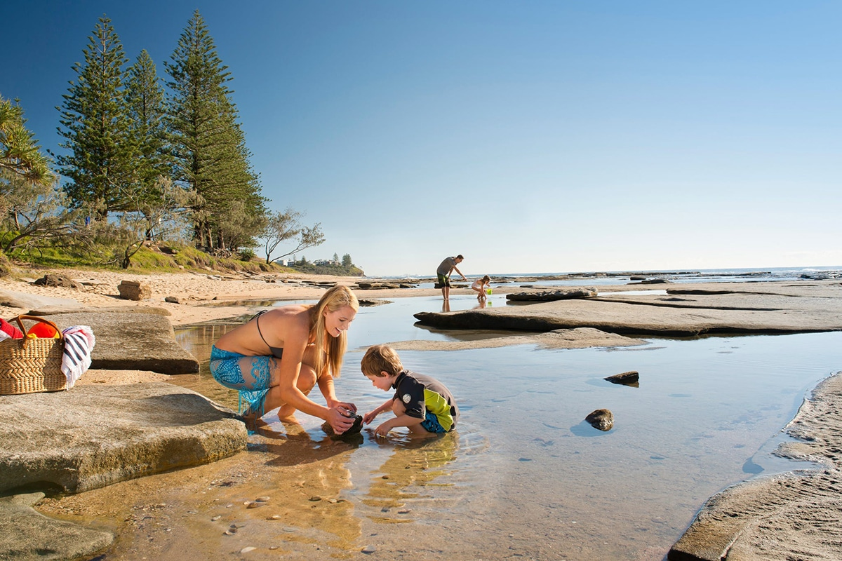 Happy Family Playing In Water On shelly beach caloundra