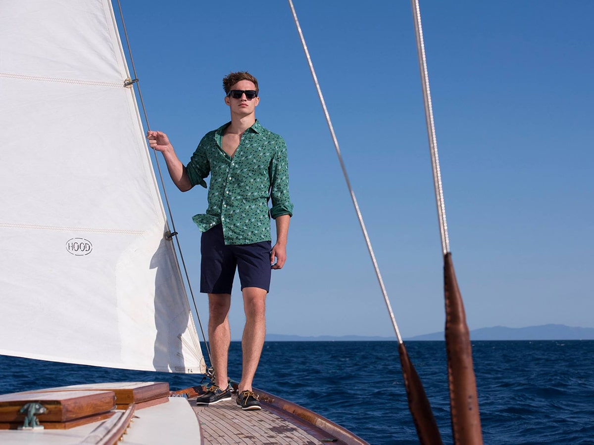 man standing on yacht in rodd and gunn clothes