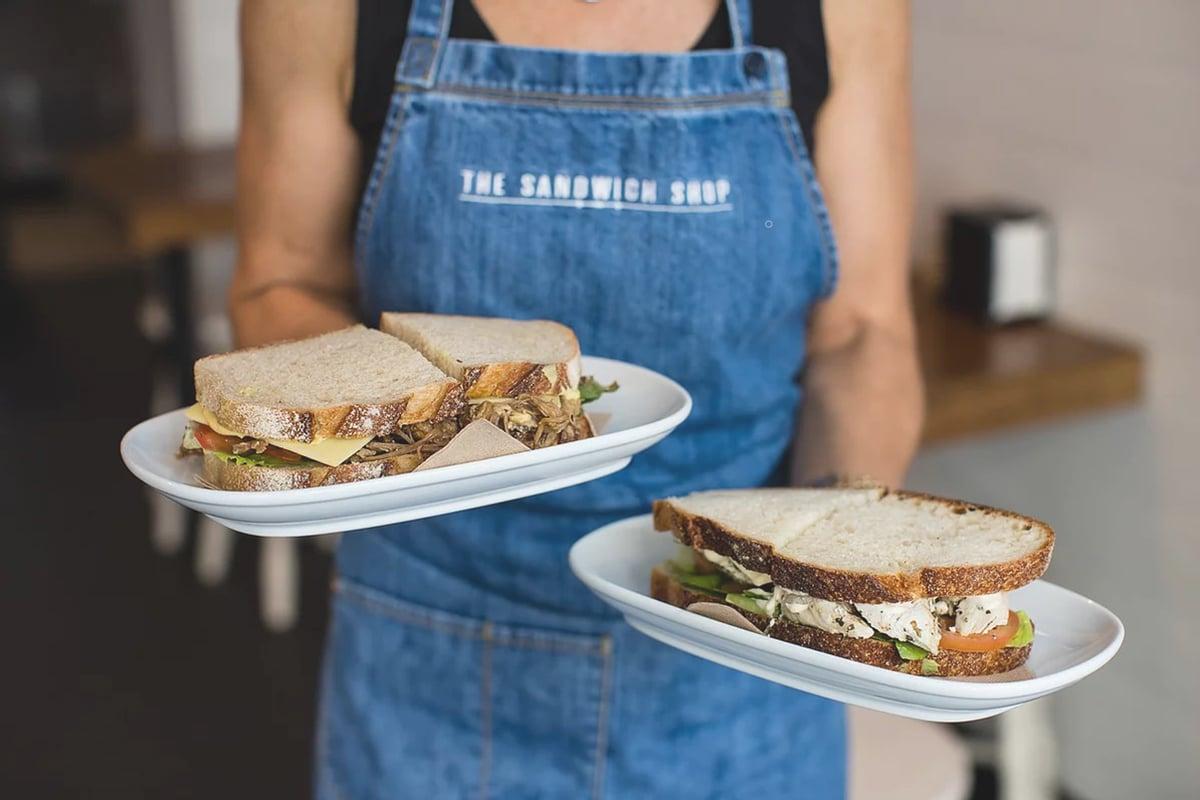 sandwich shop haymarket waitress serving sandwiches