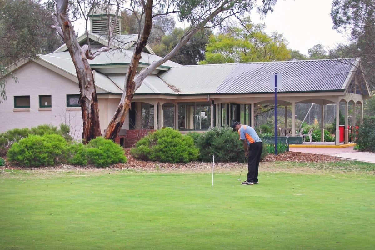 man playing golf at little para golf course