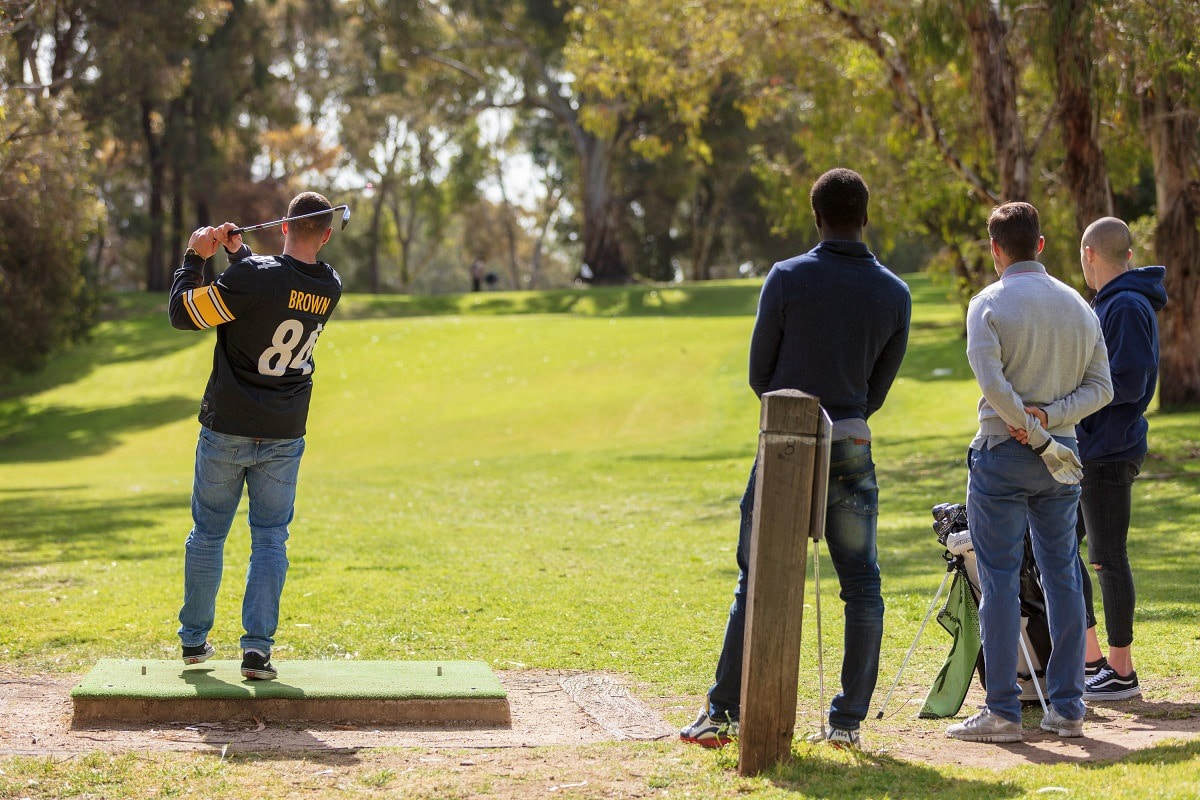 people playing golf at north adelaide golf course