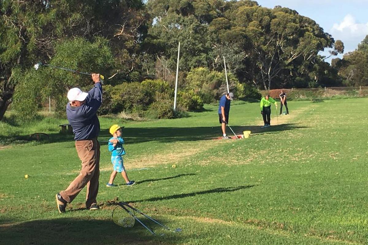 people playing golf at port noarlunga golf driving range