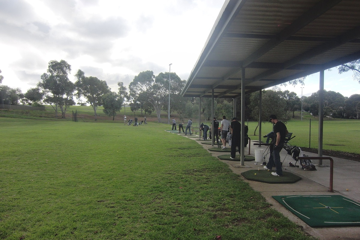 people playing golf at valley view golf driving range