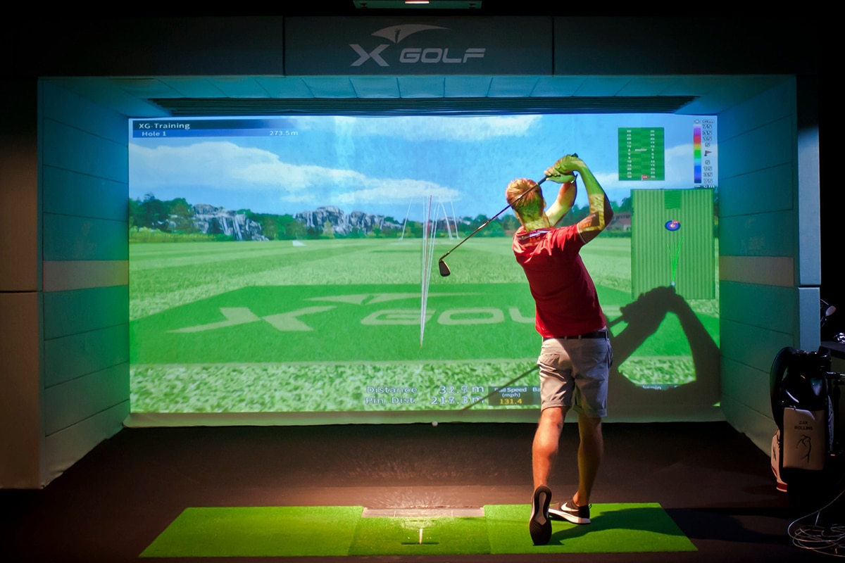 young man playing golf at x golf marion