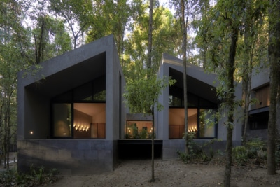 These Stunning San Simon Cabins are Craved From Grey Volcanic Stone