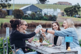 young people drinking wine at puddleduck vineyard