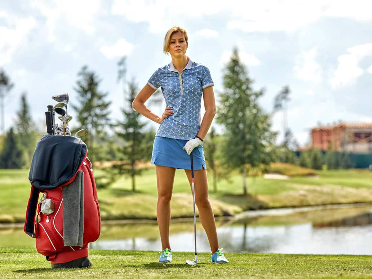 young woman with golf equpment at murdoch pines golf and recreation park