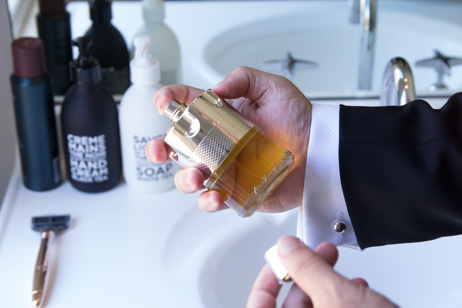 azzaro wanted fragrance bottle in the hand