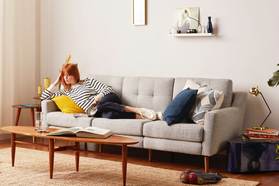 women reading book on burrow couch sofa