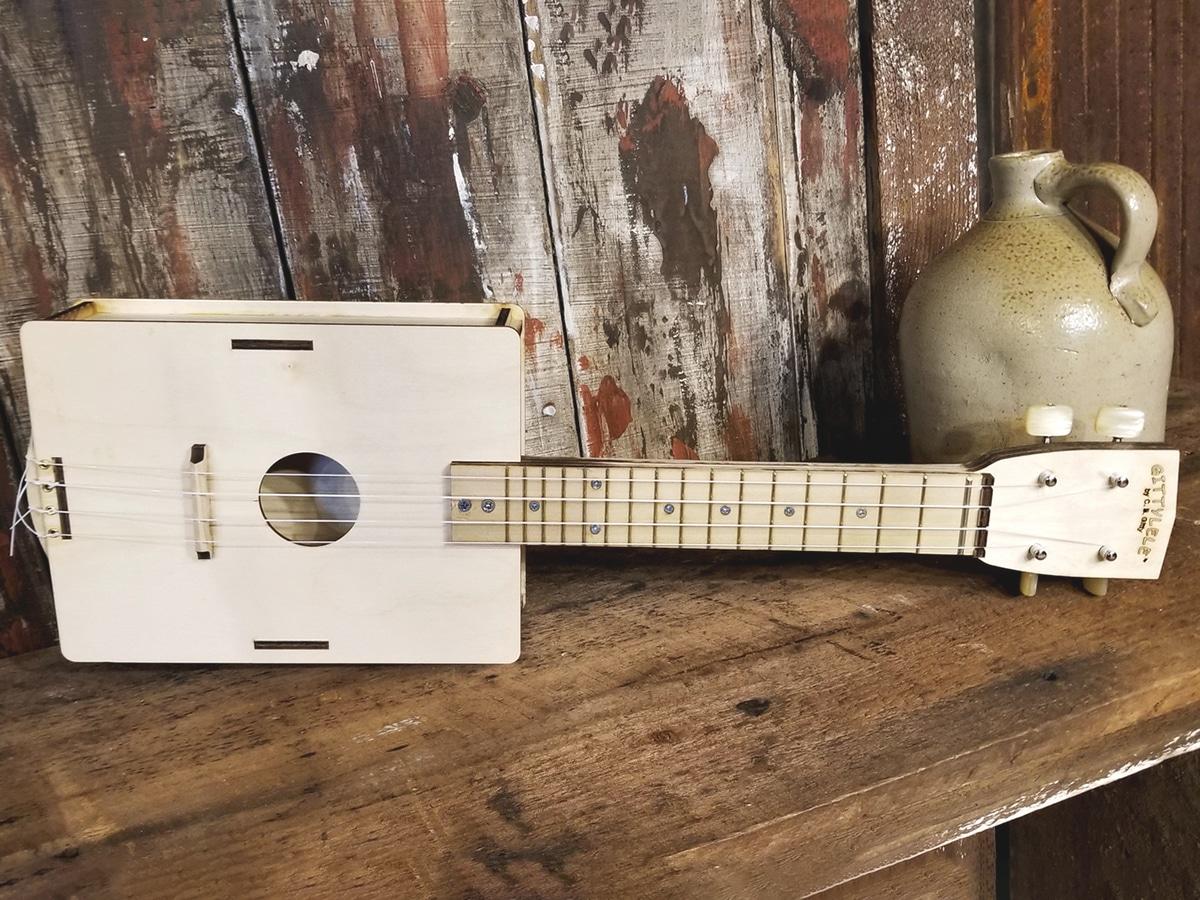 ukulele kitz on wooden table