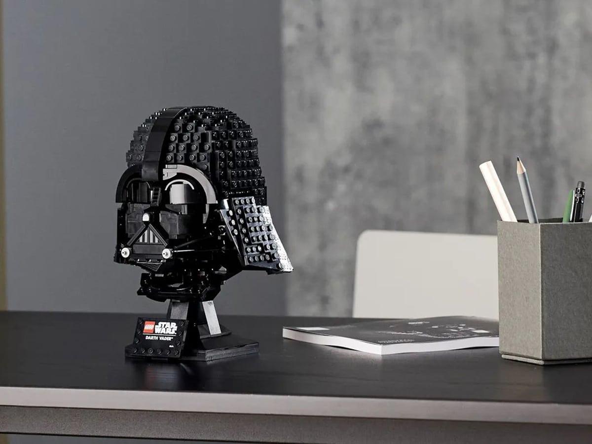 lego star wars darth vader helmet on wooden table