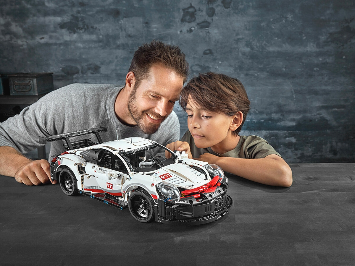 Father And Son Playing lego technic porsche 911 rsr