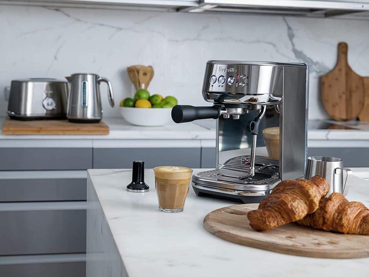 breville bambino plus espresso maker on table in kitchen