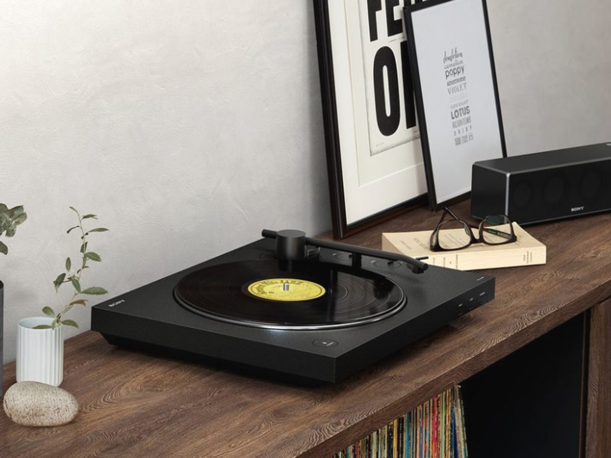 sony ps lx310bt turntable standing on wooden shelf