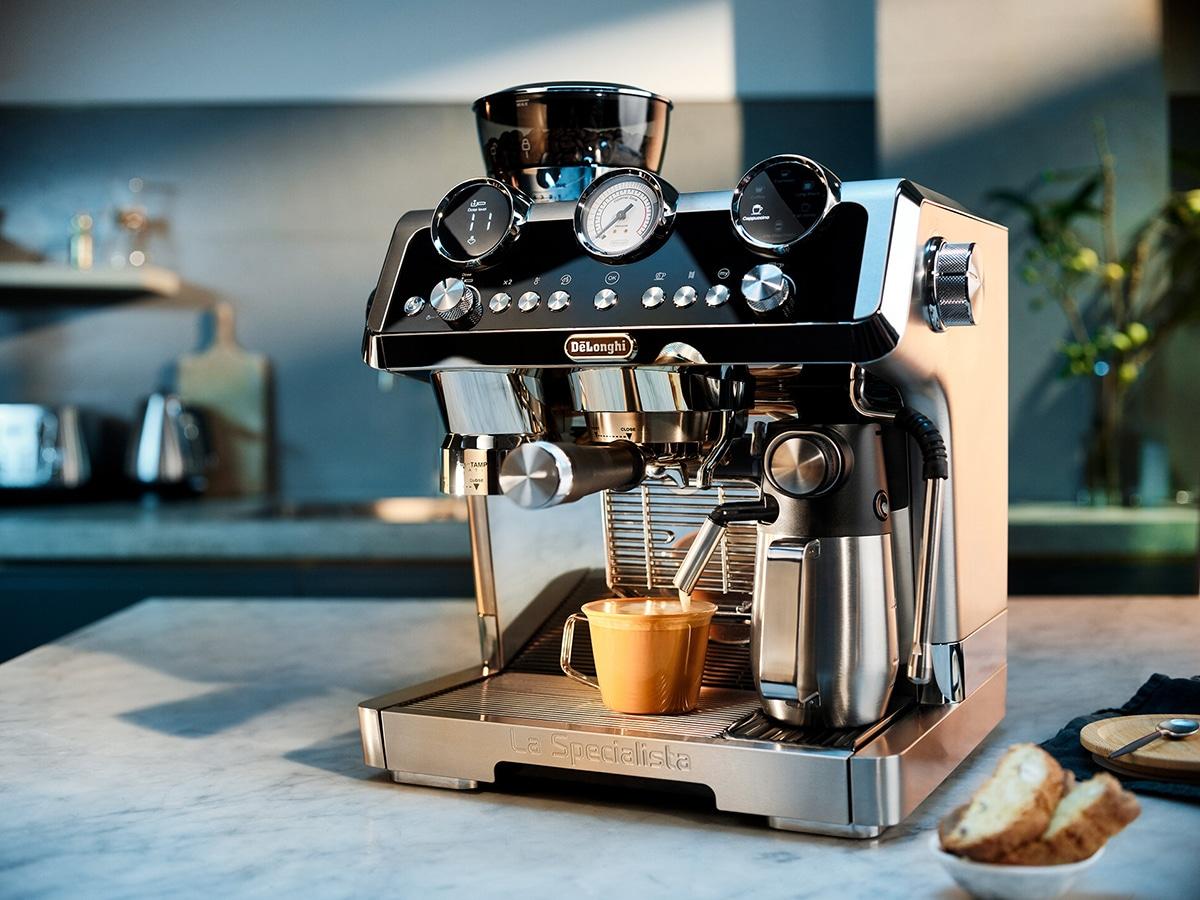 delonghi specialista maestro manual espresso machine on kitchen table