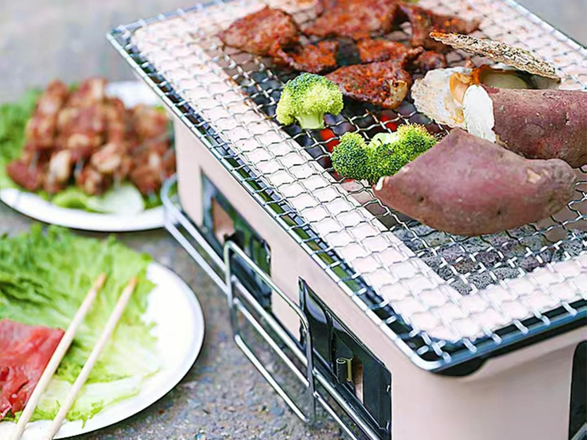 lenoxx ceramic hibachi japanese korean tabletop bbq grill with fried vegetables