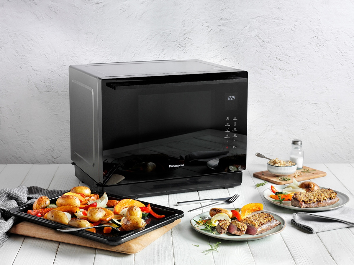panasonic 4 in 1 convection microwave oven on kitchen table