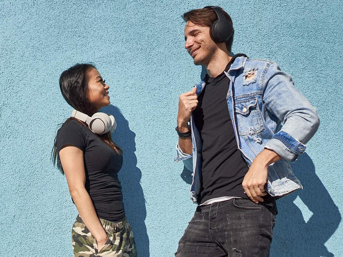 Young couple in headphones panasonic rb m700
