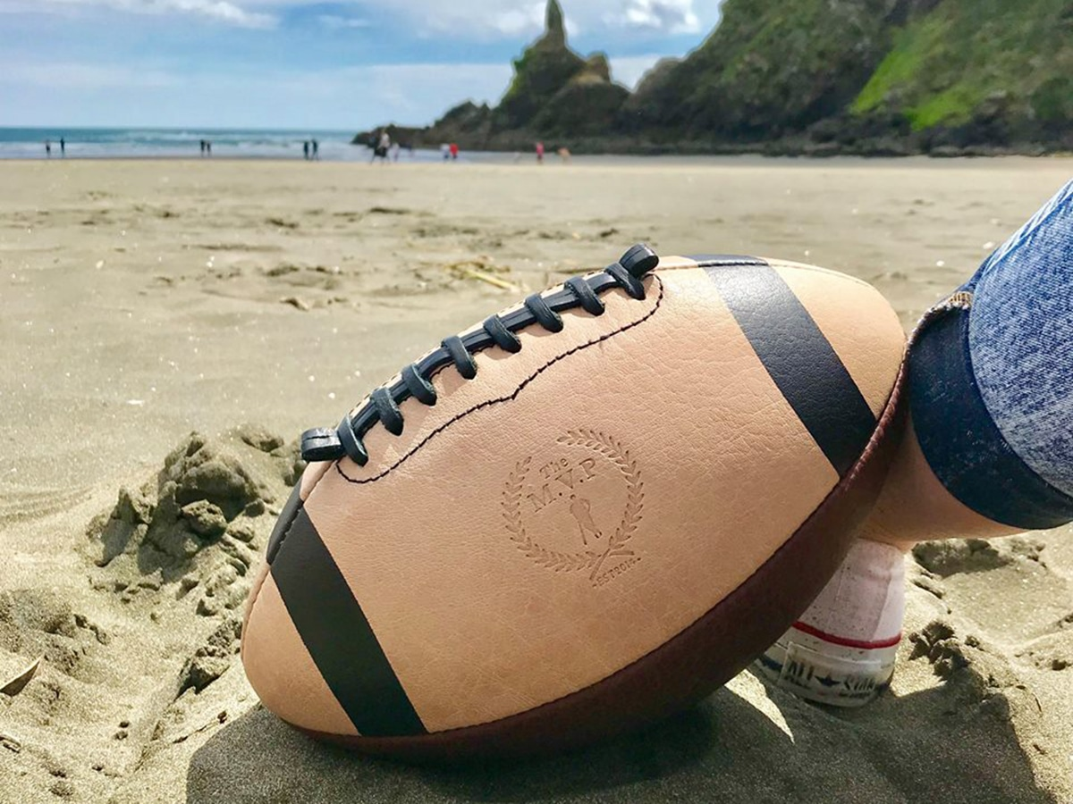 modest vintage player retro leather rugby ball on a beach