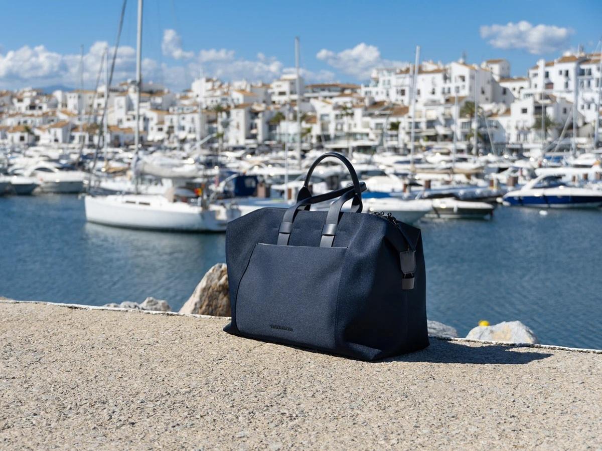 troubadour adventure weekender bag in front of yachts