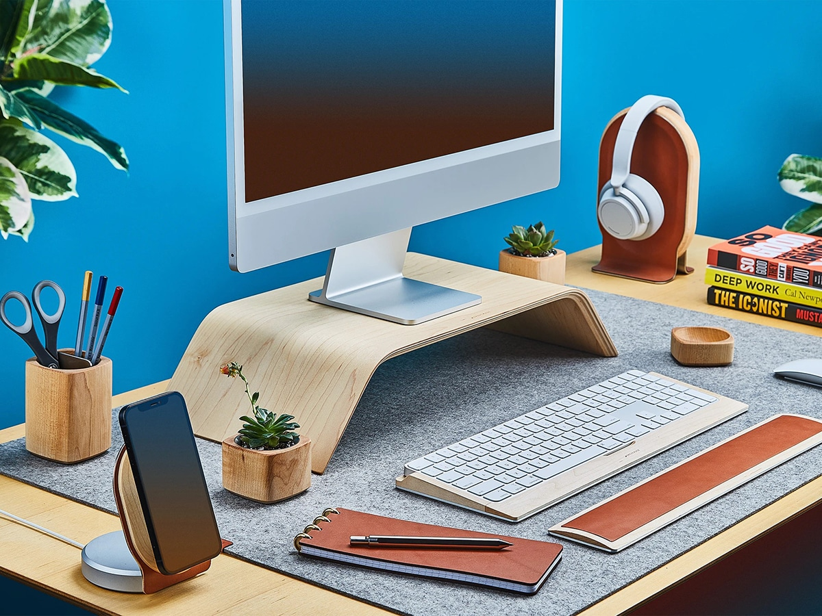 grovemade wood monitor stand with computer on the office desk