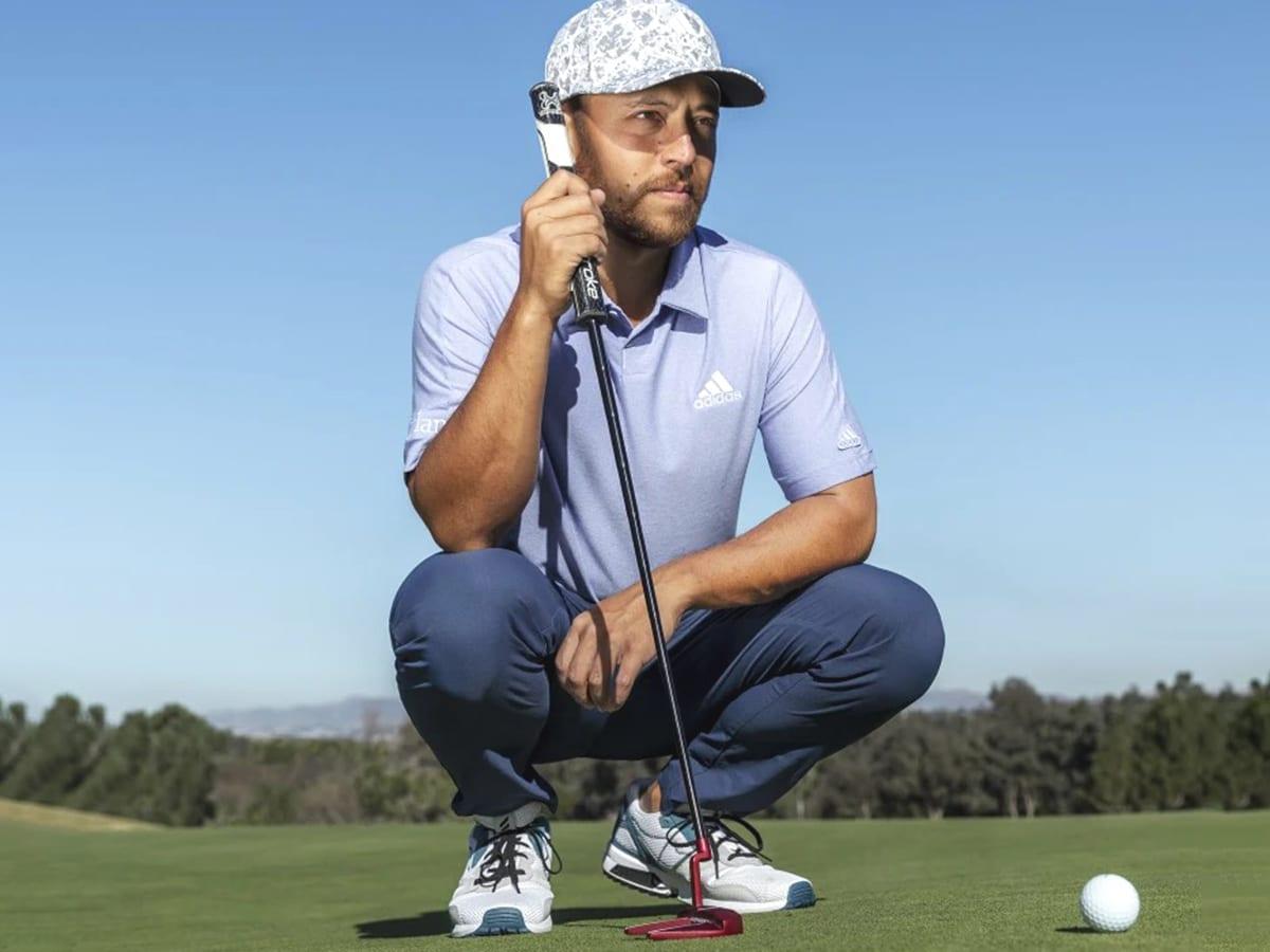 man wearing adidas zx primeblue spikeless golf shoe on golf field