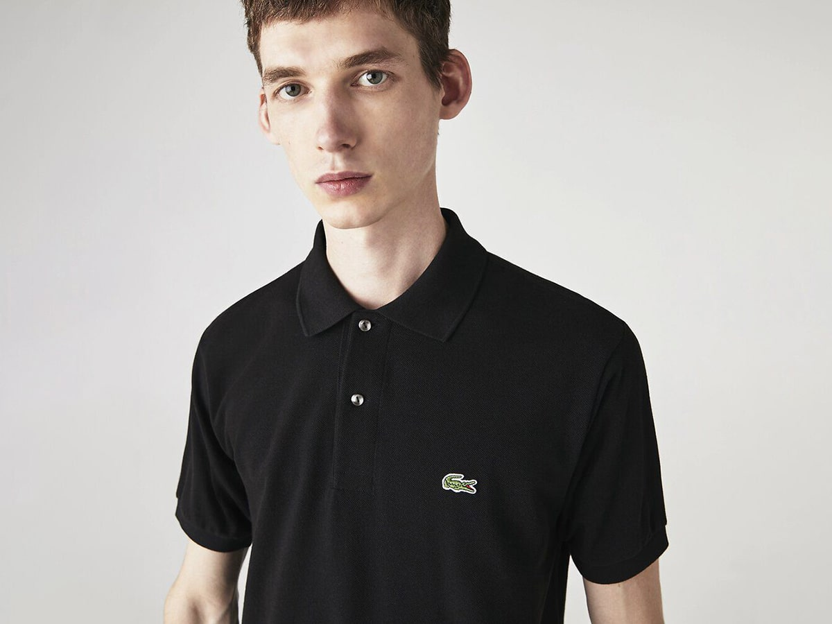 young man wearing lacoste polo