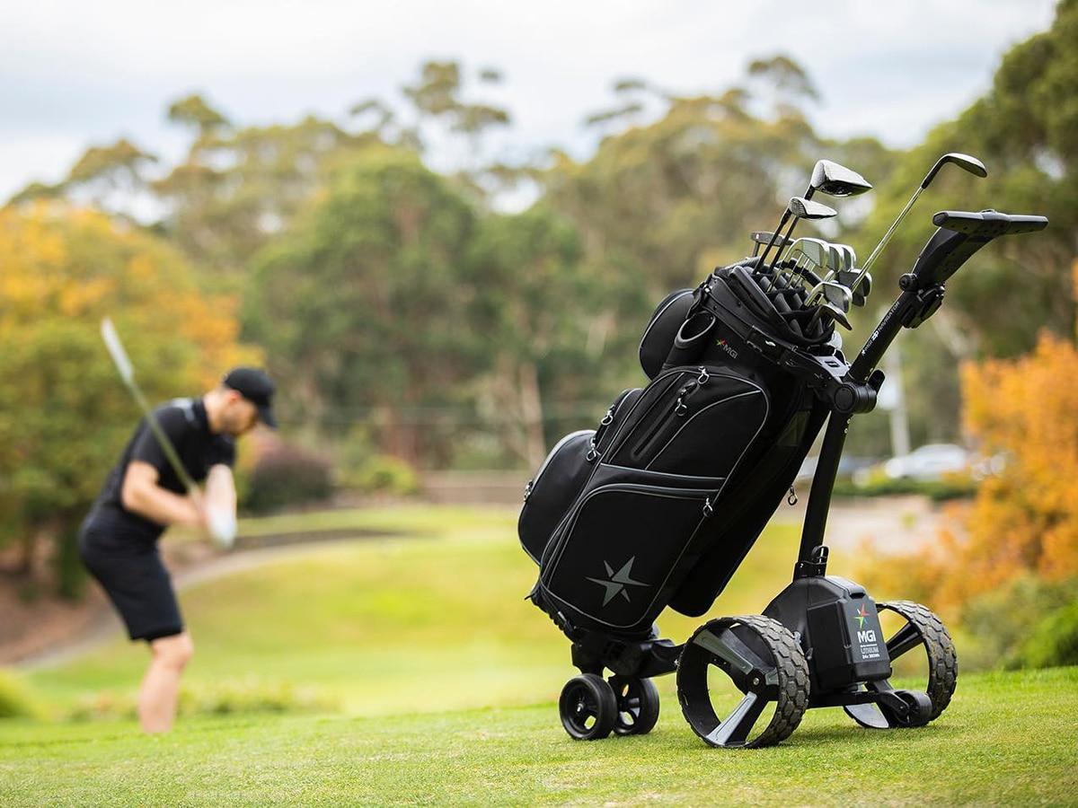 mgi zip navigator motorised buggy in front of man playing golf