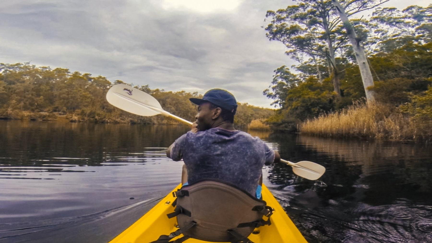 Man kayaking down river