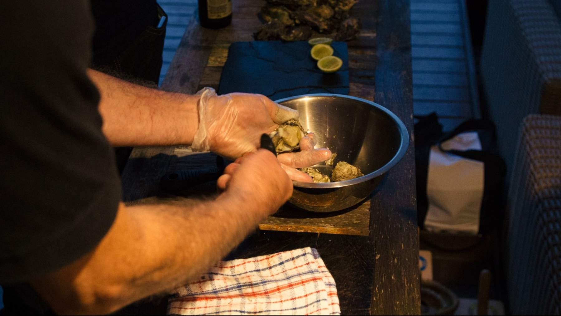 Hands shucking oysters