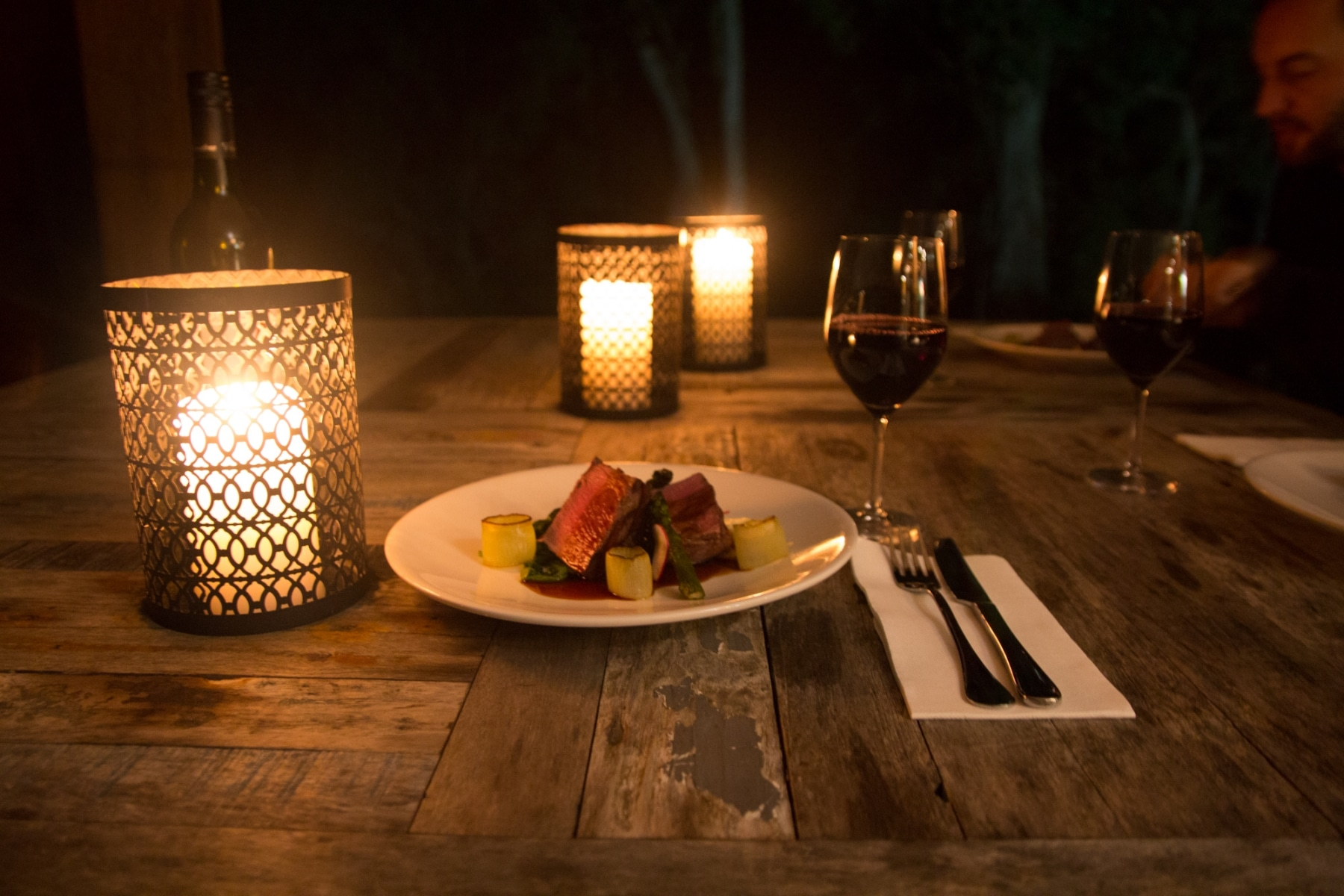 Food on candle lit table