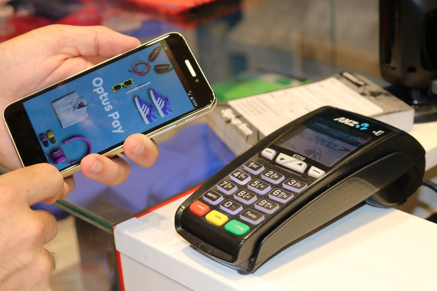 optus pay mobile in hand